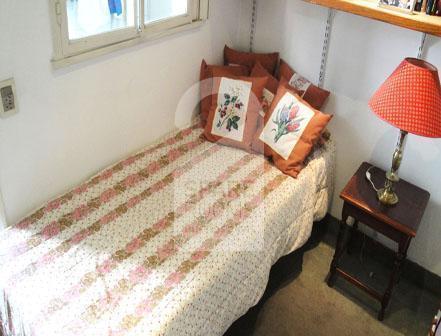 La adorable habitación en el departamento