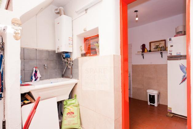 The washing site and the kitchen at the house in San Telmo.