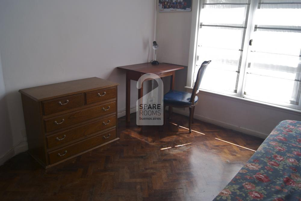 The desk and chest of drawers.