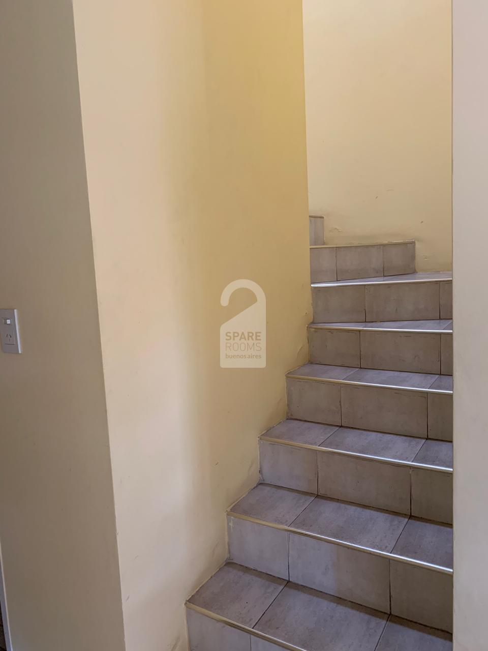 Stairs to room and shared bathrom